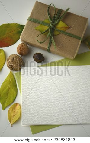 Fall Flat Layout With A Gift Box, Leaves And A Note Card. Theme Of Fall, Autumn, Thanksgiving, Grate
