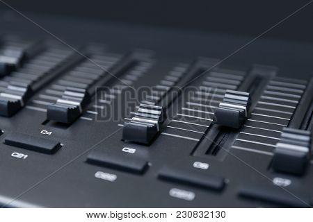Multi-channel mixer at radio station, closeup