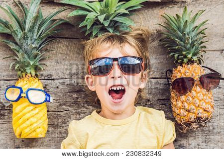 A Pineapple Boy And Pineapples On Vacation.
