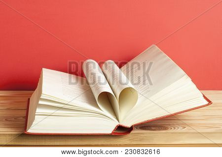Close Up Heart Shape From Paper Of Book On Red Background. Free Copy Space.education Concept.