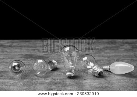 Different incandescent lamps on table