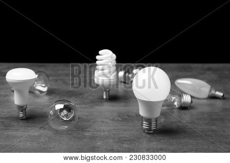 LED, incandescent and fluorescent lamps on table