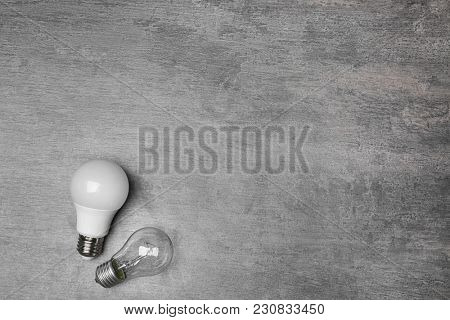 LED and incandescent lamps on grey background