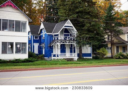 Bay View, Michigan / United States - October 16, 2017:  A Boarded Up Blue Two Story Victorian Cottag