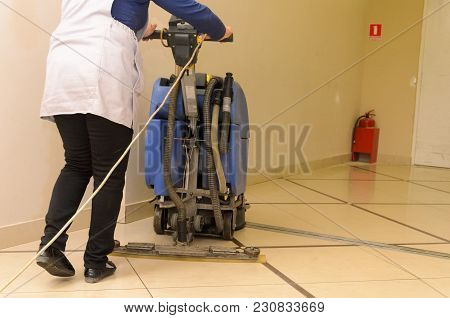 Floor Care And Cleaning Services With Washing Machine In Shopping And Entertainment Center.the Direc
