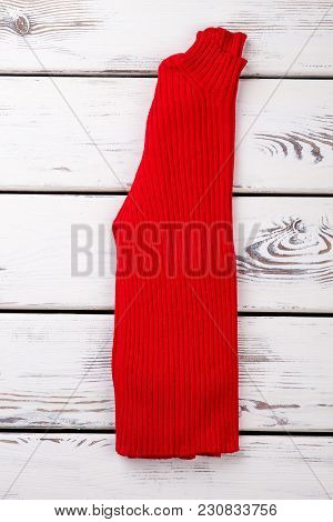 Folded Red Woolen Sweater. Vertically Folded Warm Pullover In Bright Background.