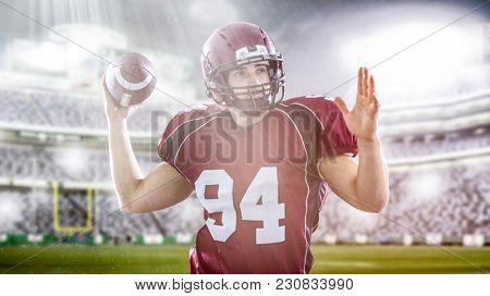 one quarterback american football player throwing ball on big modern stadium with lights and flares