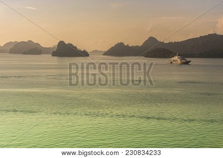 A Yacht Is Seen Navigating The Strait Of Malacca Between The Islets Of The Langkawi Archipelago Mala