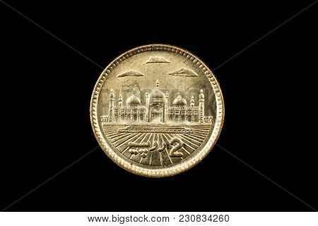 A Super Macro Image Of A 2 Pakistani Rupee Coin Isolated On A Black Background