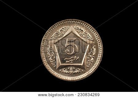 A Super Macro Image Of A 5 Pakistani Rupee Coin Isolated On A Black Background