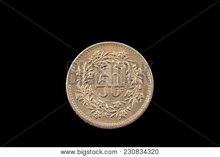 A Super Macro Image Of An Old 50 Pakistani Rupee Coin Isolated On A Black Background