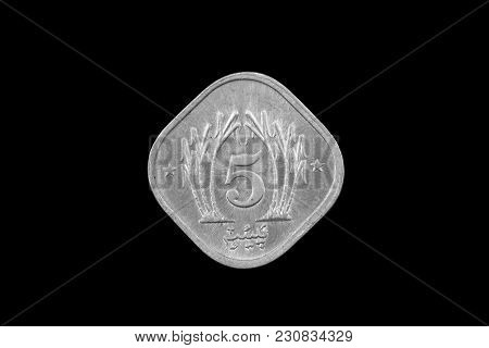 A Super Macro Image Of An Old 5 Pakistani Rupee Coin Isolated On A Black Background