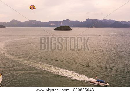 A Boat Is Seen Carrying A Parachute In The Strait Of Malacca And In The Background The Archipelago O