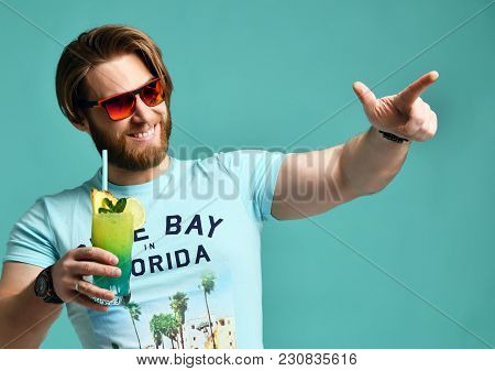 Young Man Hold Margarita Cocktail Drink Juice Happy Smiling Pointing One Finger At The Camera Over B