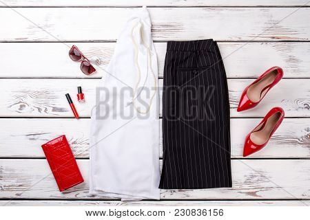 Woman Fashion Clothes Collage On Wood, Flat Lay, Top View. Beauty Feminine Look With Shirt, Trousers
