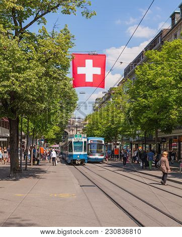 Zurich, Switzerland - 24 April, 2014: View Along Bahnhofstrasse Street. Bahnhofstrasse Street Is The