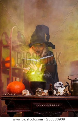Portrait of witch on cauldron with steam