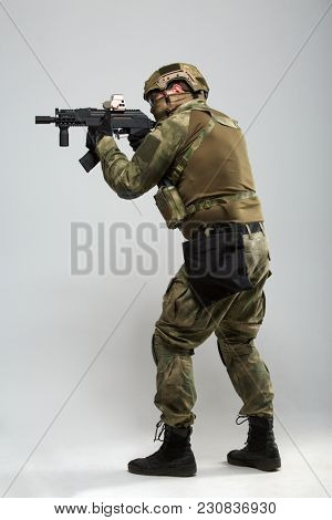 Image of aiming military man with gun