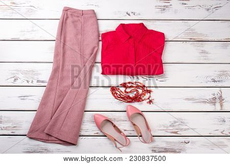 Summer Collection Women Clothes Outfit, Flat Lay. Red Folded Shirt, Ling Skirt, Pair Of Shoes And Ne