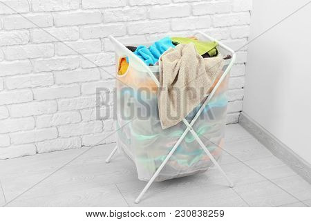 Laundry basket with dirty clothes indoors