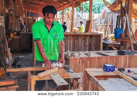 Sukhothai, Thailand - June 4, 2011: Carpenter Making Furniture From Wood In The Workshop In Sukhotha