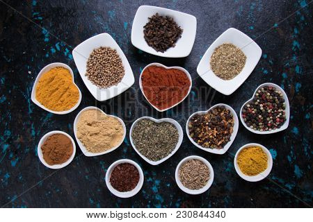 Various colorful spices used in indian, european,mediterranean and international cuisine