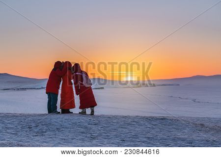 Three Tourist Taking Selfie In Sunset At Frozen Lake Baikal In Siberia, Russia. Travelling In Winter
