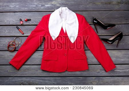 Fancy White Blouse, Jacket And Make-up Accessories. Flat Lay. Grey Wooden Surface Background.