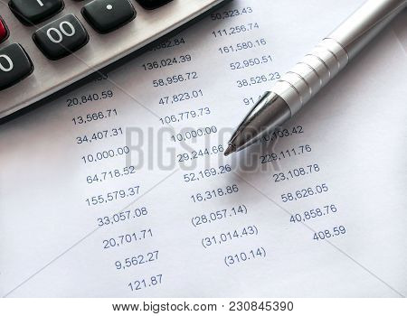 Financial Spreadsheet Data With Pen And Calculator. Accounting Financial Concept.