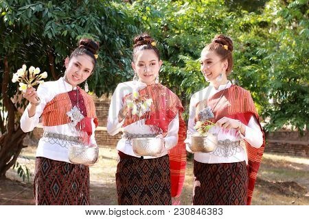 Welcome Songkran Festival In Thailand,beautiful Thai Girl In Thai Costume,asian Woman Wearing Tradit