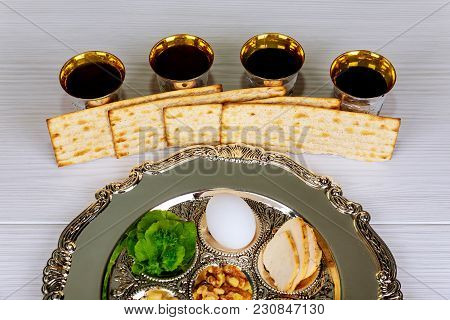 Pesah Celebration Concept Jewish Passover Holiday . Traditional Pesah Plate Text In Hebrew: Passover