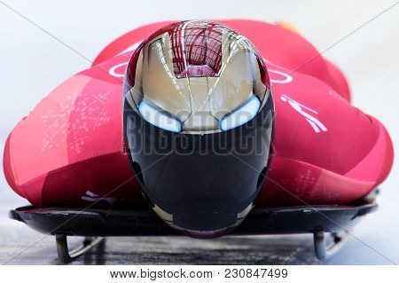 PYEONGCHANG, SOUTH KOREA - FEBRUARY 14, 2018: Olympic champion  Sungbin Yun of South Korea competes  in the Skeleton Men Official Training Heat at the 2018 Winter Olympics in PyeongChang, South Korea