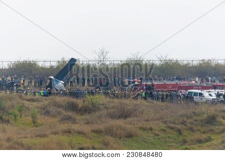 KATHMANDU, NEPAL - MARCH 12, 2018: Bangladeshi airline US-Bangla flight BS211crashed on landing at Nepal's Kathmandu airport. Rescue operation on the way.