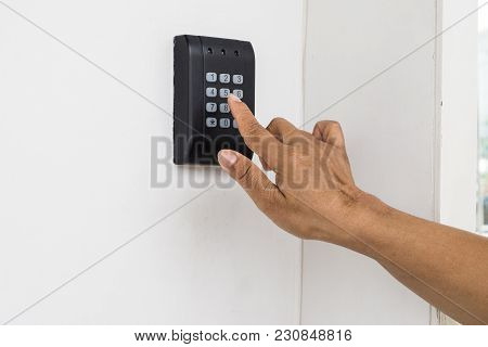 Human Hand Presses On The Button, Entering Security System Code. Combination Pin Code On Keypad. Pas