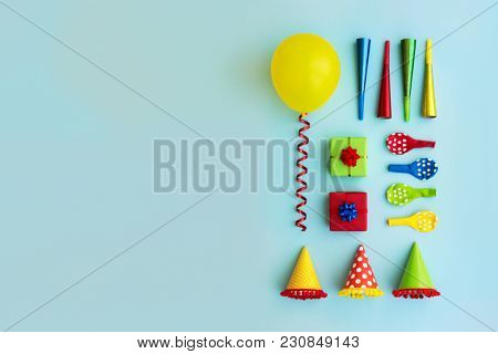 Colorful collection of birthday party objects from above