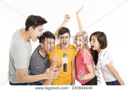 Group Of Happy Friends Singing Song Together