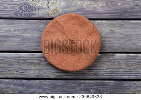 Top View Beret Hat. Top View, Flat Lay, Wooden Desk Surface Background.