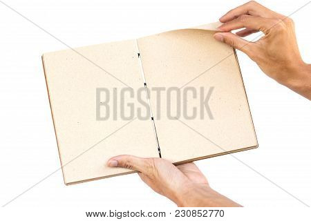 Hand Holding Open Hand Made Book Isolated On White Background. Clipping Path.  Hand Made Book Is Bea
