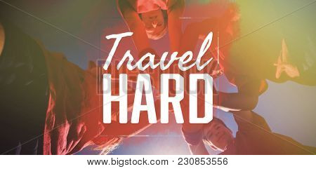 Travel hard against kids forming hand stack in the boot camp
