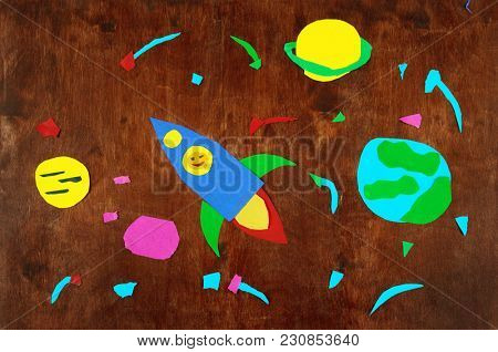 space rocket and planets, solar system, Astronautics and stars on wooden background-application made by child