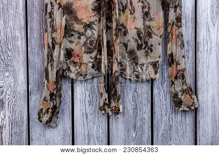 Abstract Print Blouse With Bow, Close Up. Flat Lay, Top View. Grey Desk Surface Background.