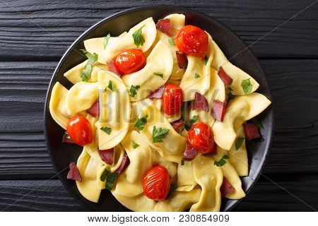 Homemade Dumplings Stuffed With Ham, Cherry Tomatoes And Fresh Herbs Close Up On A Plate On The Tabl