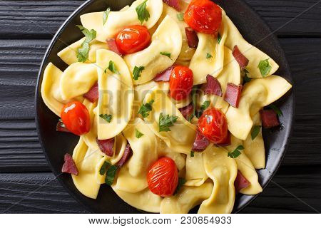 Traditional Italian Pasta Casoncelli With Prosciutto Filling, With Cherry Tomatoes Close-up. Horizon