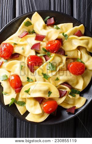 Traditional Italian Pasta Casoncelli With Prosciutto Filling, With Cherry Tomatoes Close-up. Vertica