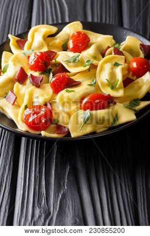 Italian Dumplings Casoncelli Stuffed With Ham With Cherry Tomatoes Close-up On A Plate. Vertical