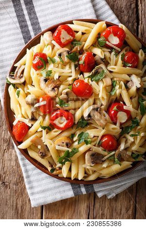 Vegetarian Food: Pasta Penne With Champignons, Tomatoes, Stuffed Peppers Close-up. Vertical Top View