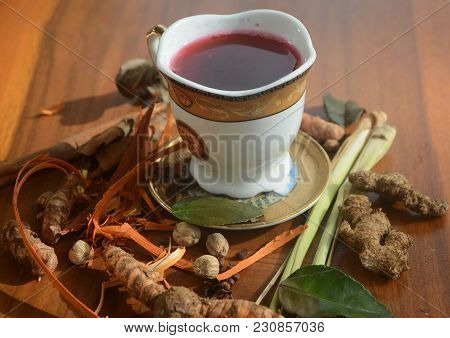 Jogja Traditional Drink. Spices Tea Called Wedang Secang Or Wedang Uwuh Presented With A White Porce