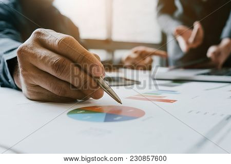 Close Up Businessman And Partner Hand Holding Pen During Calaulating Finance, Tax, Accounting, Stati