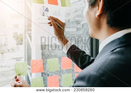 Businesspeople Discussing And Planning Concept. Front Of Glass Wall Marker And Stickers. Startup Off