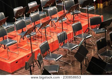 Empty Chairs On A Stage In Concert Theater